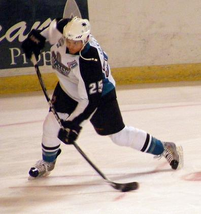 picture of hockey player during the impact stage of slapshot
