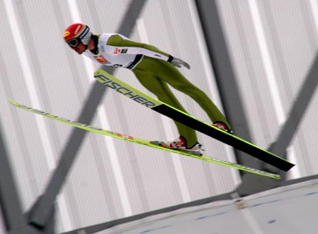 picture of ski jumper making v shape with his skis
