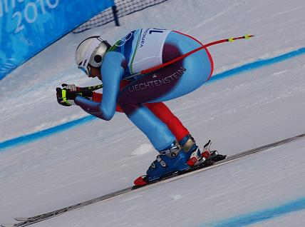 downhill skier in a crouch position to minimize drag