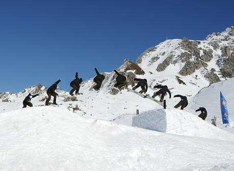 picture of snowboarder doing frontside 180